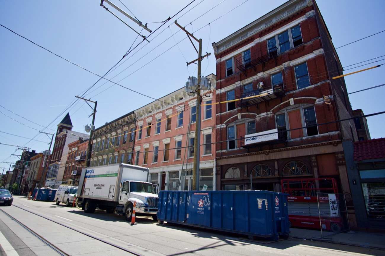 <p>Market Square is a multi-phase project still underway. It involved the purchase and redevelopment of buildings around Findlay Market, including those along Race Street to the east and Elm Street to the west. When complete next year, a built-out market district will surround Findlay, and it'll be a sight to behold. / Image: Brian Planalp</p>