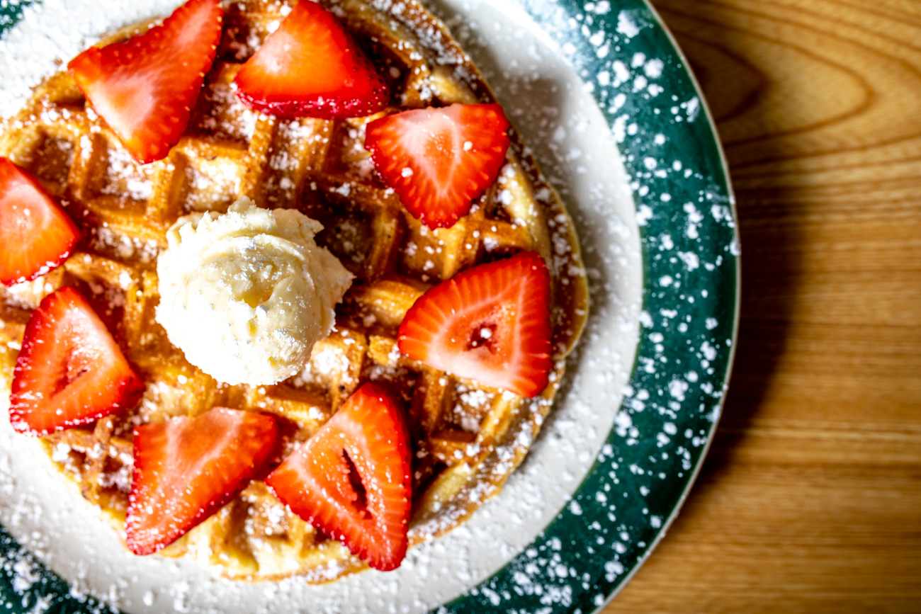 Belgian Waffle: Crispy on the outside, light and airy inside, and served with powdered sugar (fresh strawberries or blueberries available) / Image: Amy Elisabeth Spasoff // Published: 6.24.18