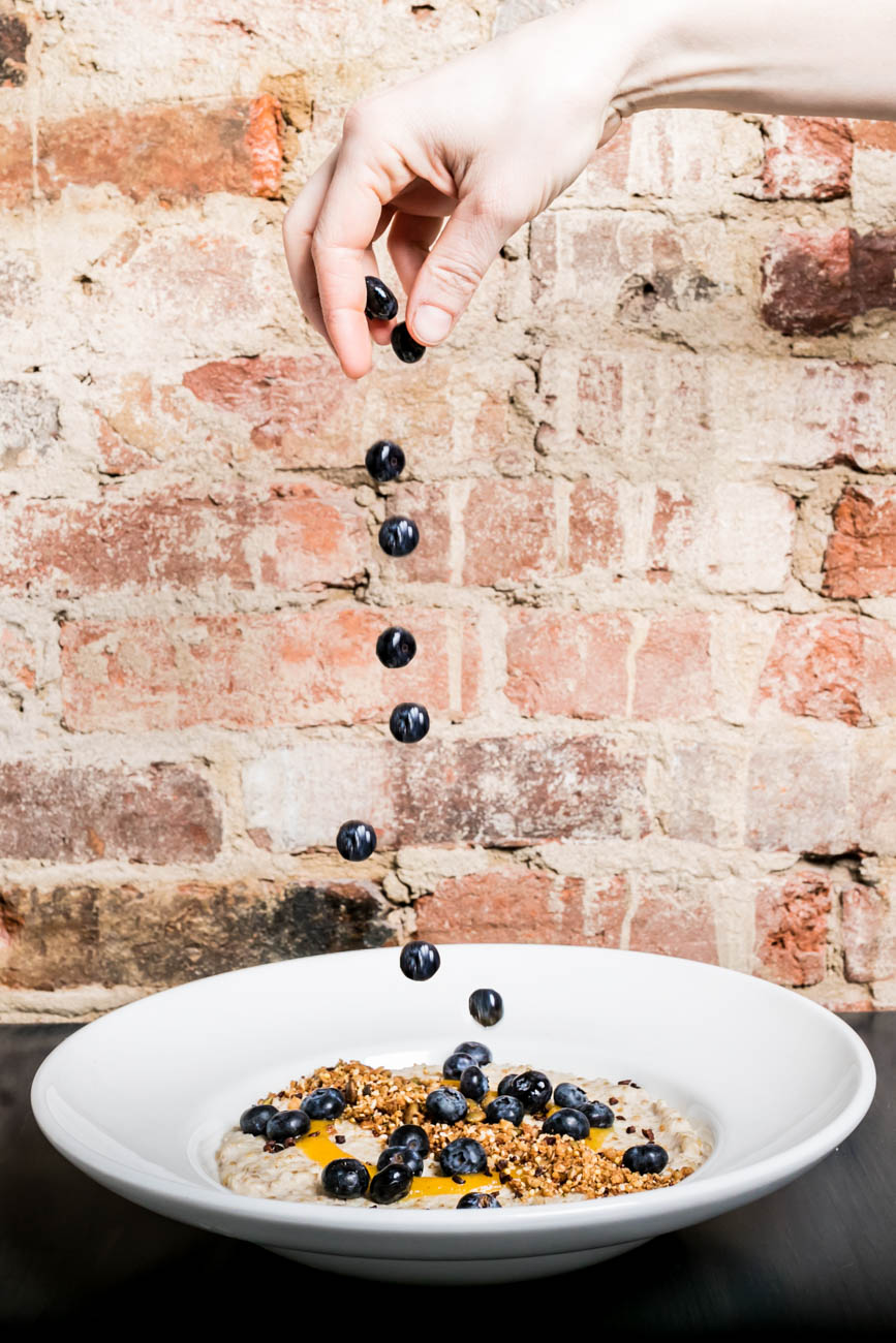 Tahini & Apricot Oatmeal: steel-cut oatmeal baked with tahini, topped with a scoop of hemp, almond and cocoa nib granola, a drizzle of citrus apricot honey coulis and fresh blueberries / Image: Amy Elisabeth Spasoff // Published: 3.4.18