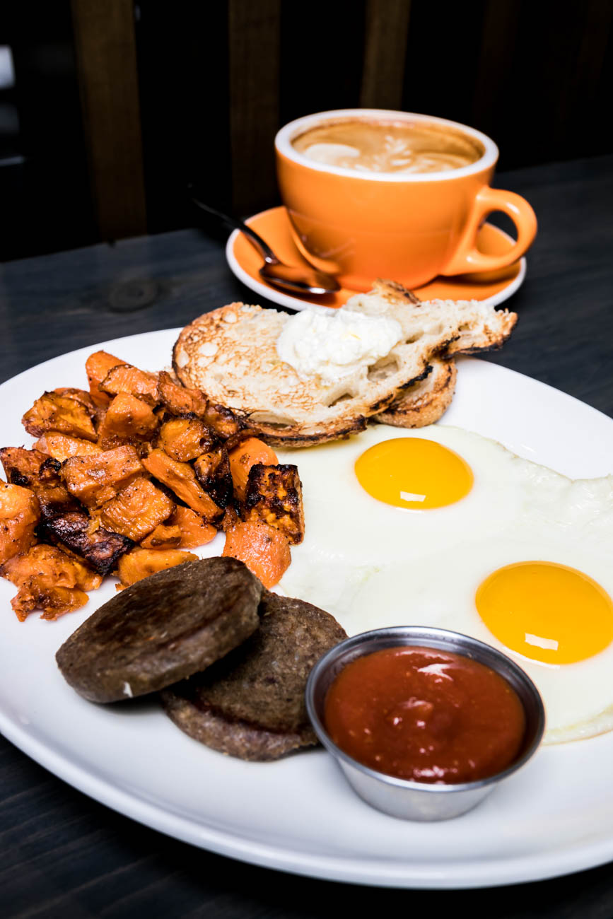 The Worker Bee: two eggs any style with your choice of bacon, sausage, goetta, or vegan veggie sausages (pictured), toast, and a side (tofu scramble is available as a vegan alternative) / Image: Amy Elisabeth Spasoff // Published: 3.4.18<p></p>